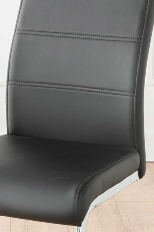 Mercury Black Faux Leather Swing Dining Chair