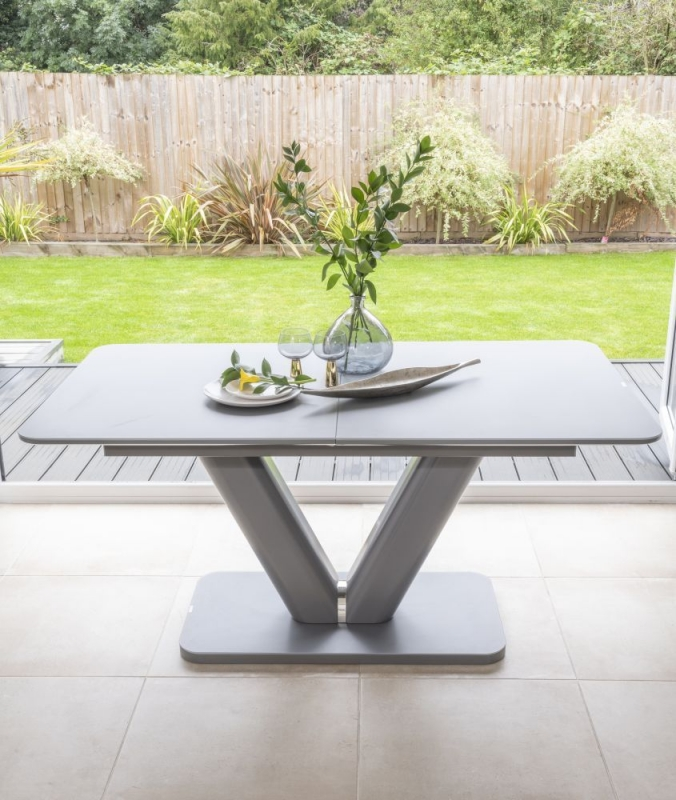 Bergen Matt Grey 160cm-200cm Drop Leaf Dining Set with 4 Mercury Taupe Faux Leather Swing Chairs and Get 2 Extra Chairs Worth £128 For FREE